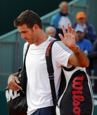 Juan Martin Del Potro of Argentina leaves the court after being defeated by Jarkko Nieminem of Finland during the Monte Carlo Masters in Monaco